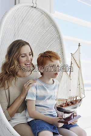 happy mother and son with model