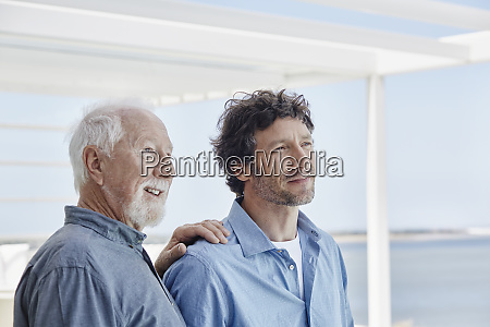 portrait of senior man with adult