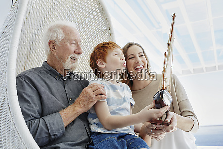 happy grandfather mother and son with