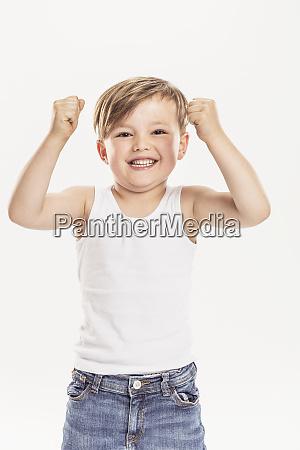 portrait of little boy clenching fists