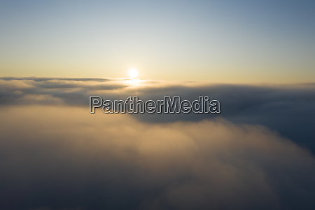 drone view of sun rising over