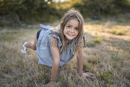 portrait of happy little girl playing