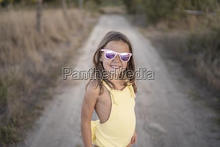 portrait of little girl wearing mirrored