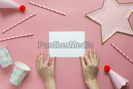 hands of woman preparing birthday decorations