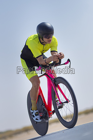 confident cyclist riding bicycle on road
