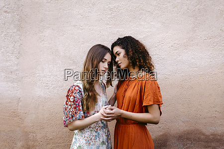 portrait of two young women holding