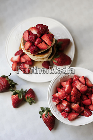 overhead view of pancakes with strawberries