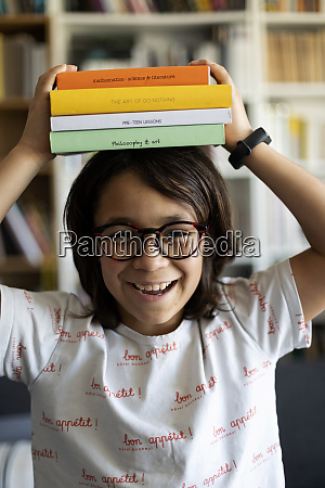 portrait of laughing boy with stack