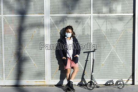 portrait of boy wearing protective mask