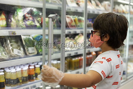 boy with mask in supermarket