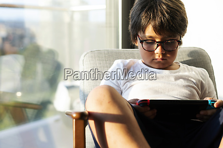 boy playing video game on a