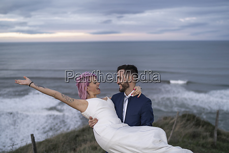 bridal couple on viewpoint and ocean