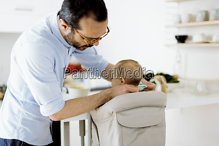 father with baby in high hair