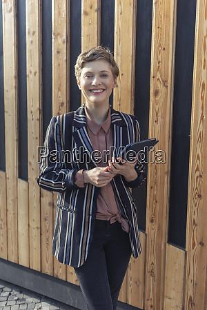 portrait of happy businesswoman with digital