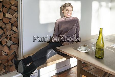 happy female customer sitting with digital