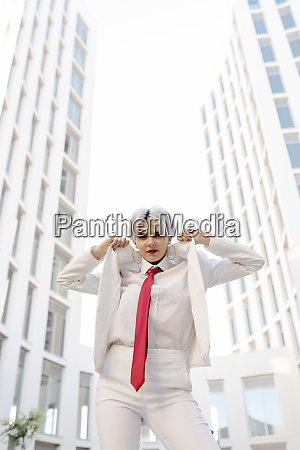 cool young woman wearing white suit