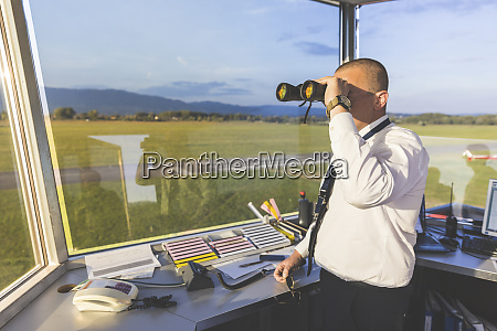 pilot standing in control tower using