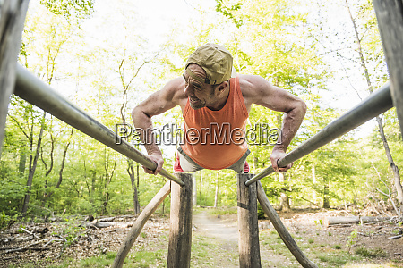 mature man doing push ups on