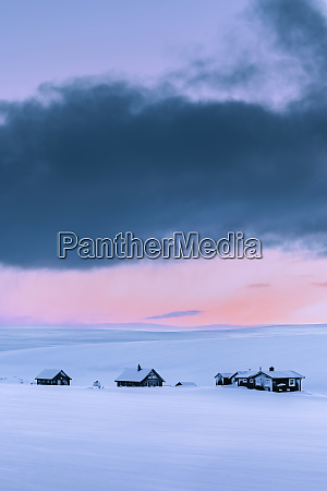 remote vacation homes in winter landscape