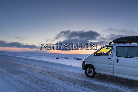 camper van on country road in