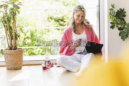 portrait of smiling mature woman sitting