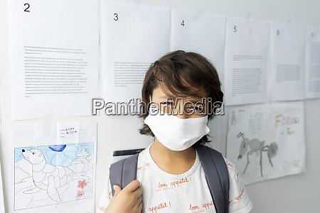 close up of boy wearing mask