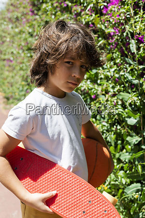 close up of boy with basketball