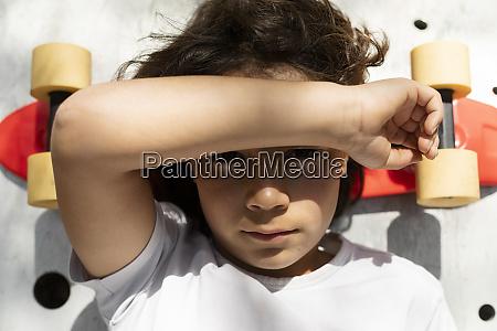 close up of boy lying on