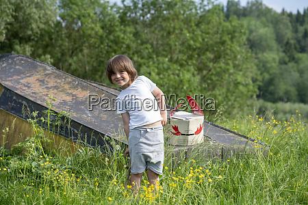 smiling boy with mask on abandoned