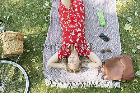 relaxed woman with eyes closed lying