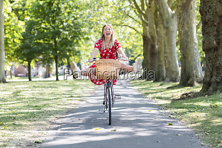 cheerful woman with feet up riding
