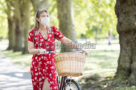 woman wearing mask while walking with