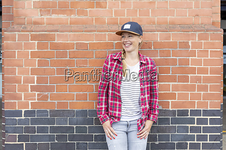 smiling woman wearing checked shirt and