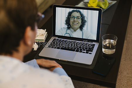 smiling doctor on video call with