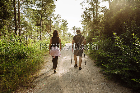 rear view of couple hiking in