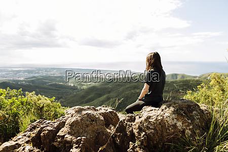 hiker enjoying view at viewpoint