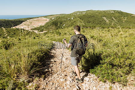 hiker on stony hiking trail