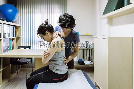female physiotherapist working with client