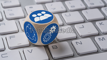 a die with icons on a