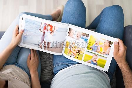 couple family looking photo album
