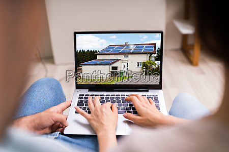 couple family searching real estate online