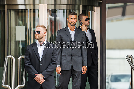security guard service protecting business man