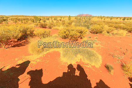 camel riding in australian desert with