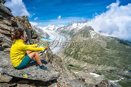woman looking at map sitting on