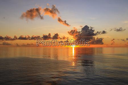 sunset over beautiful calm sea interesting