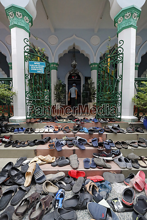 shoes outside the mosque friday prayers