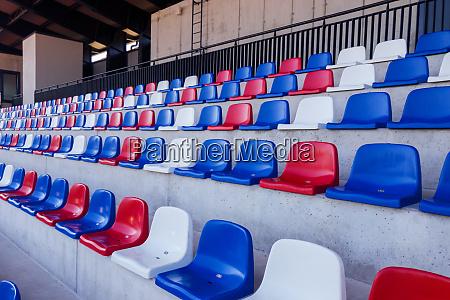 empty plastic seats at the sport