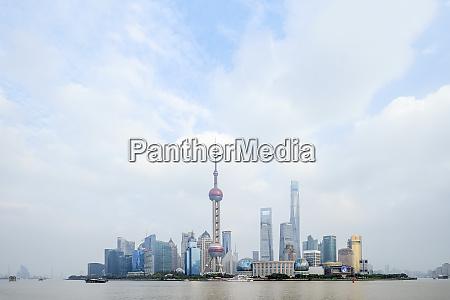 the shanghai city skyline with the