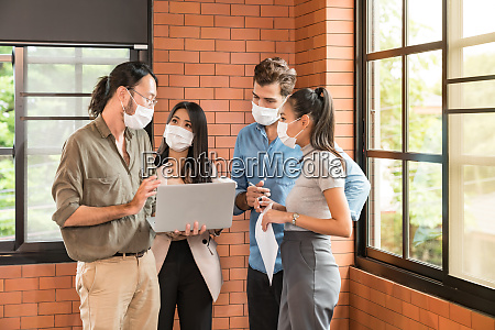 businee person meeting with face mask