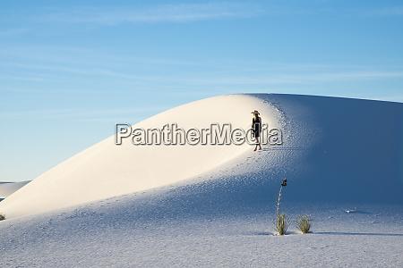 a woman strolls along the ridge